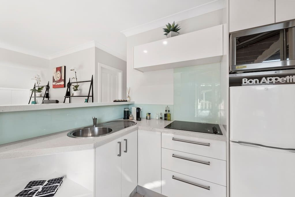 Your Stone bench Kitchenette with full stove top, small Convention Oven / Microwave, Nespresso Coffee machine includes free coffee pods, sugar, milk and milk frother, tea. oil, balsamic vinegar, salt & pepper.
