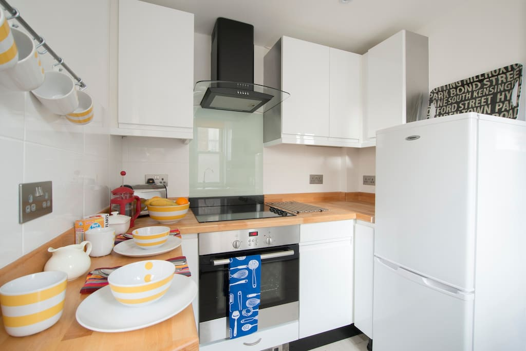 Fully fitted kitchen with small breakfast bar.