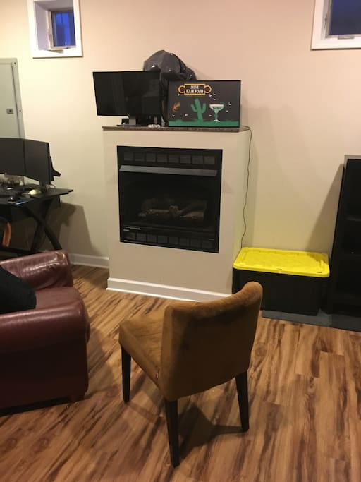 Here is a work desk fire place and living area. This is directly leftof the air matress.