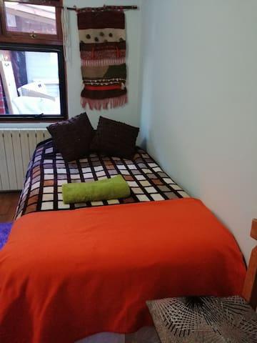 Dormitorio calefacción central.