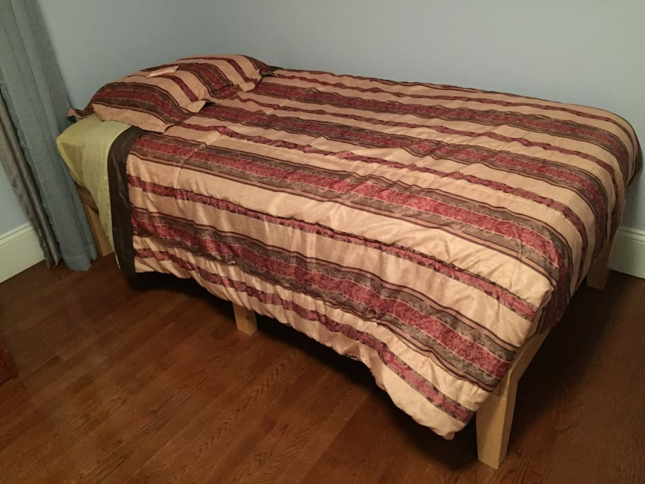 One of the two new twin-size beds in bedroom