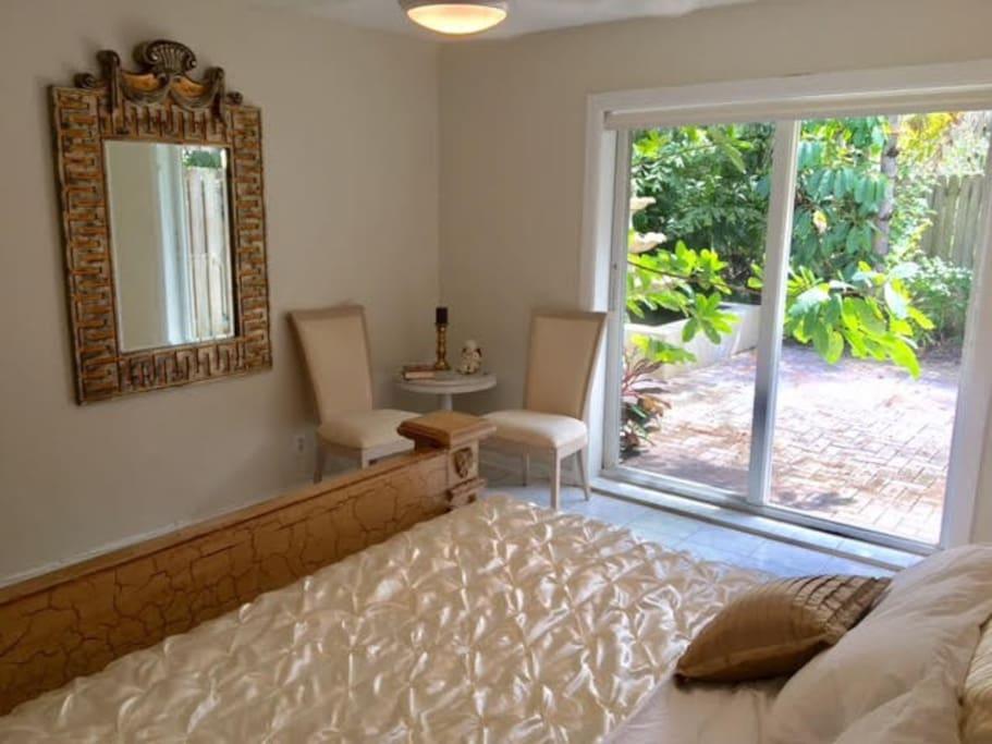bedroom w view to courtyard garden