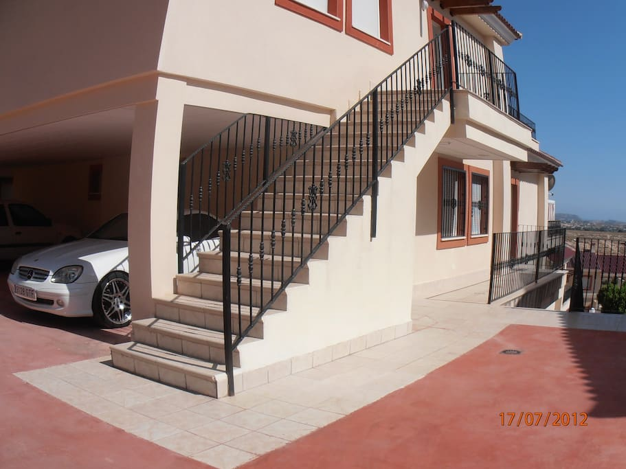 Parking and stairs to front entrance