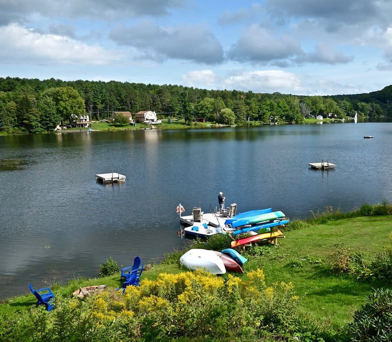 Taken from right next door at your hosts' house, showing our shared waterfront. Your view is very similar from the Helderberg Cottage upper deck. A guest caught some beautiful bass right off of the dock! The boats are available for guests' use.