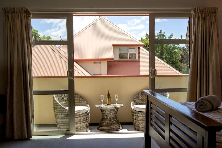 Enjoy a bottle of wine on the balcony