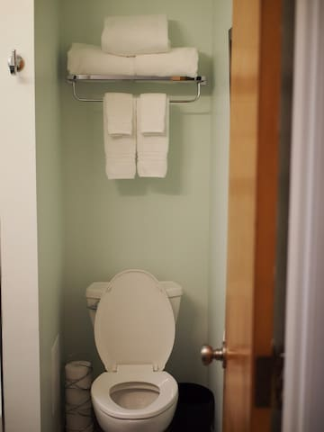 the shared bathroom which is the second door to the left as you walk down the hallway