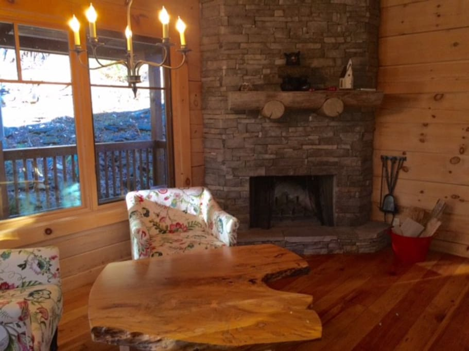 Sitting area with wood-burning fireplace.