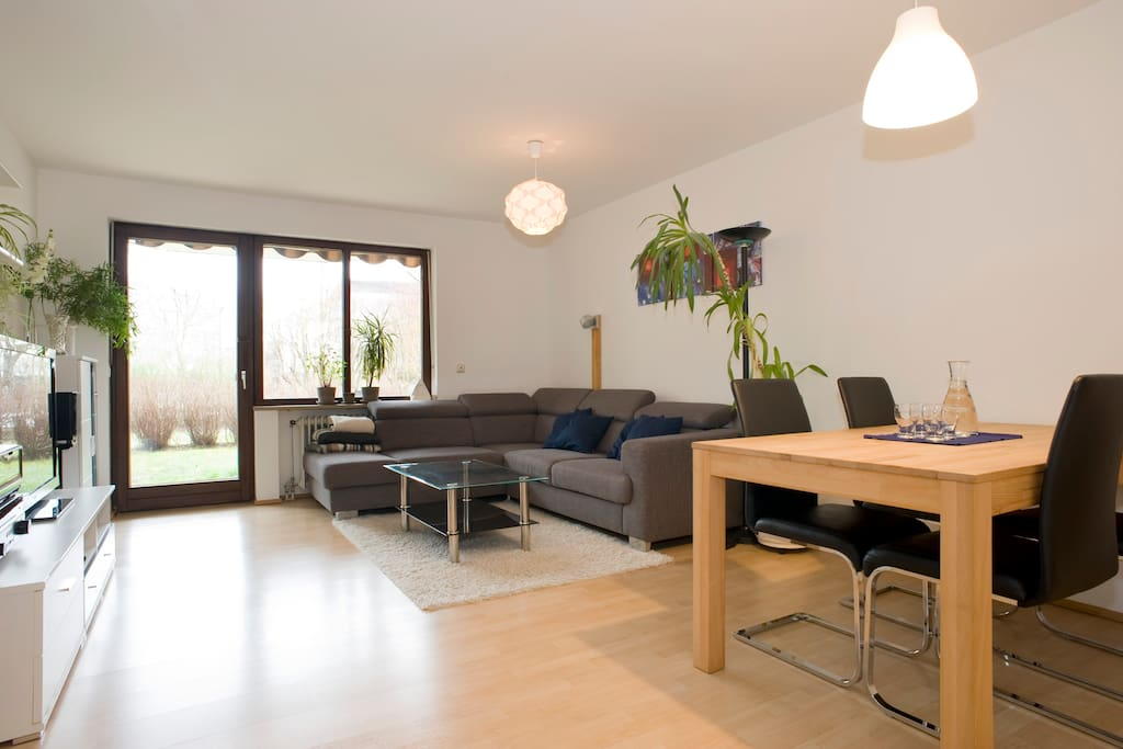 Spacious bright living room with garden access