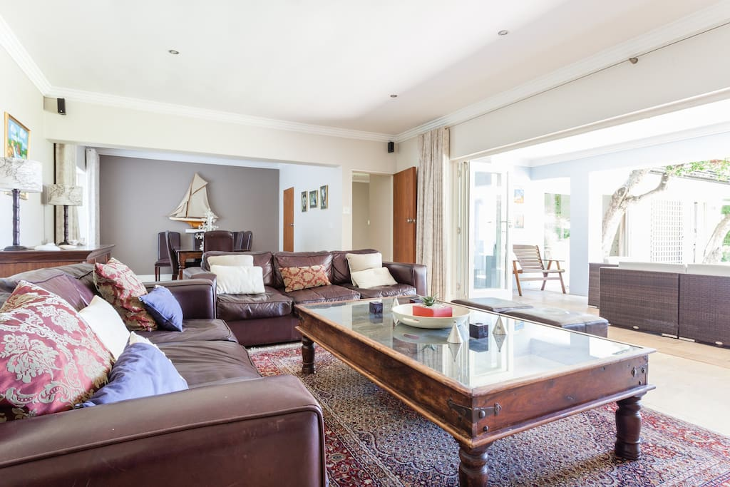 Lounge and adjoining dining room with fold-a-side doors leading to outside entertainment area