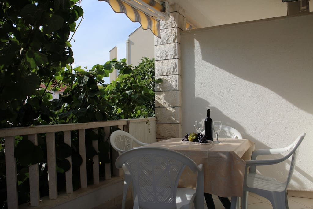 Enjoy  rest of the day on a balcony with a glass of wine