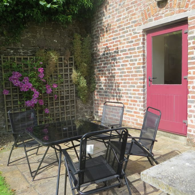 Have breakfast on the patio or enjoy a sundowner watching your children play in the old walled garden.
