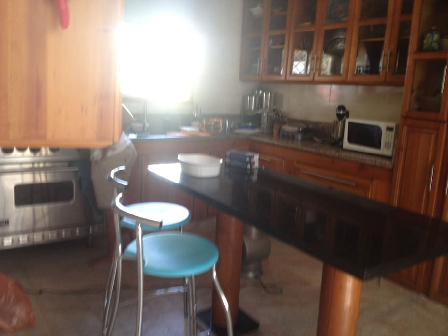 Amazing Kitchen with viking refrigerator and range .