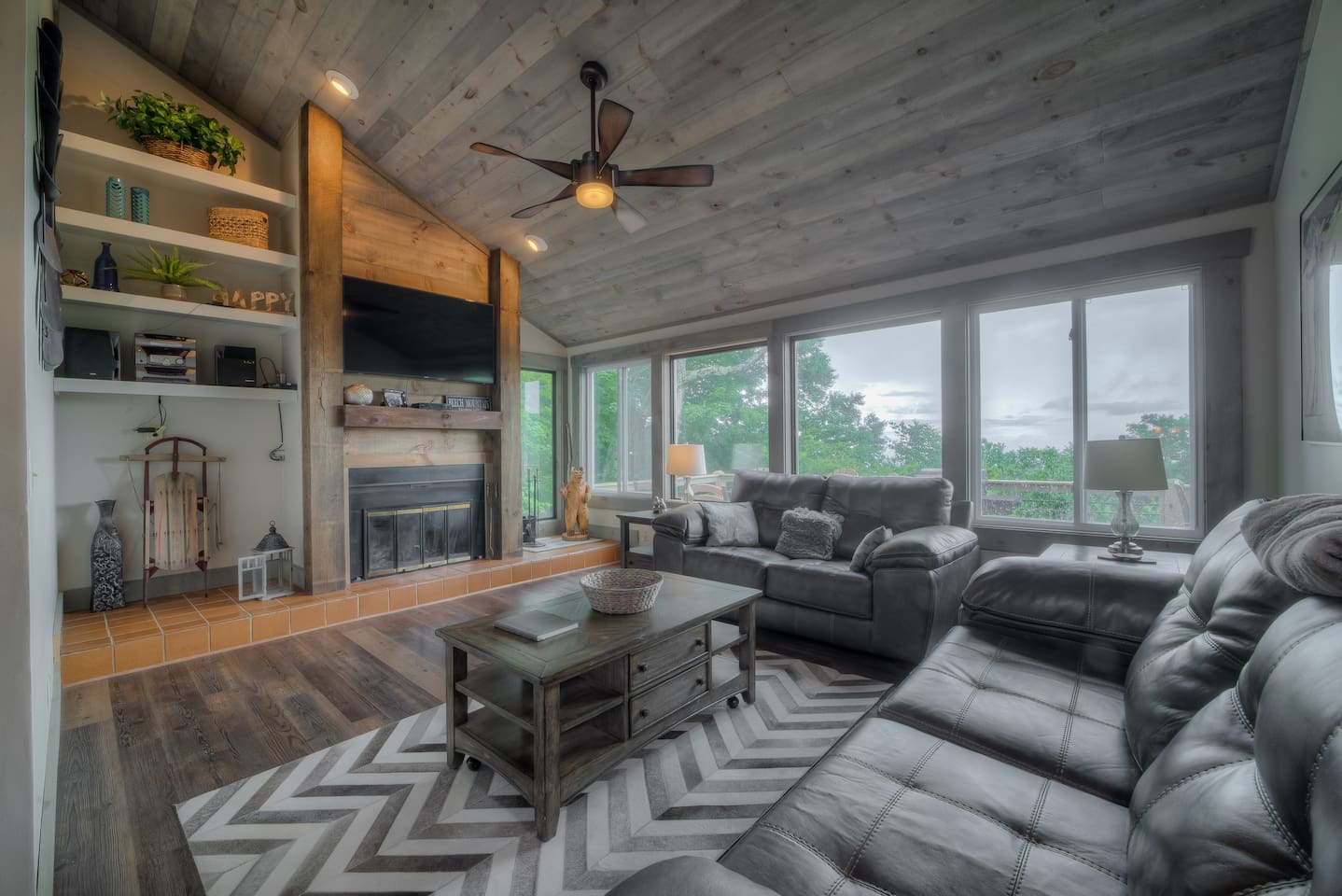 """Great room with 55"""" smart tv & wood burning fireplace"""