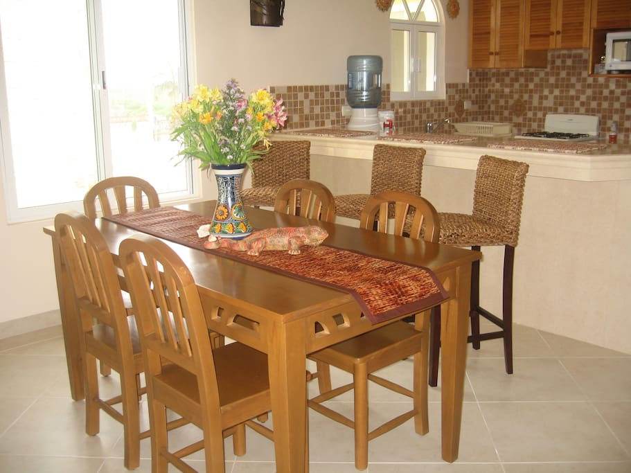 Great dining seating for 9 with great views of the beach.
