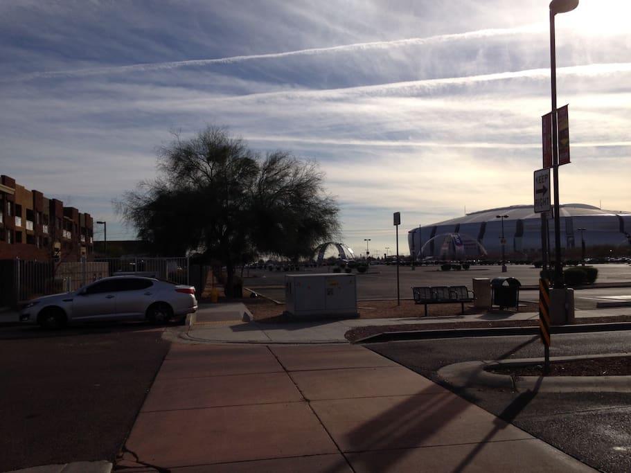Community on left, University of Phoenix Stadium  across street on right.