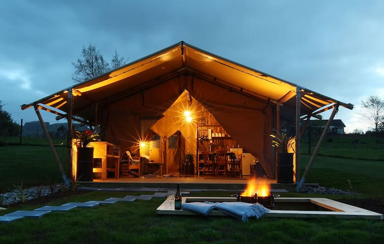 luxury tent with hot tub and kitchen