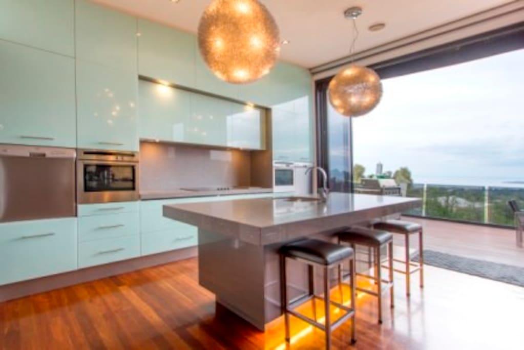 Kitchen to opening deck doors. 2 ovens, 2 dishwashers!