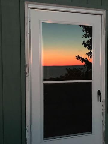 Sunset reflected in deck door.