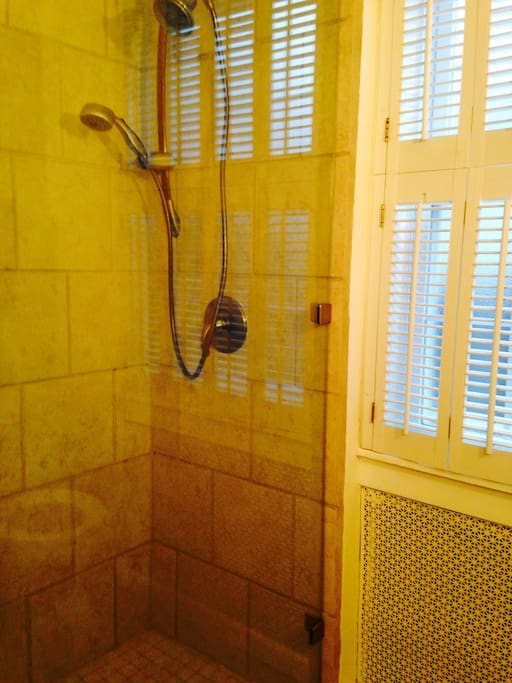 Main floor glass enclosed shower and tile floors.