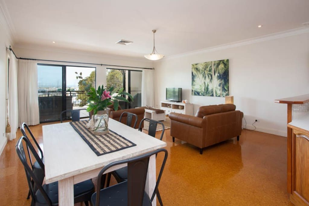 Beautifully furnished, open plan lounge and dining area leading onto private balcony with views.