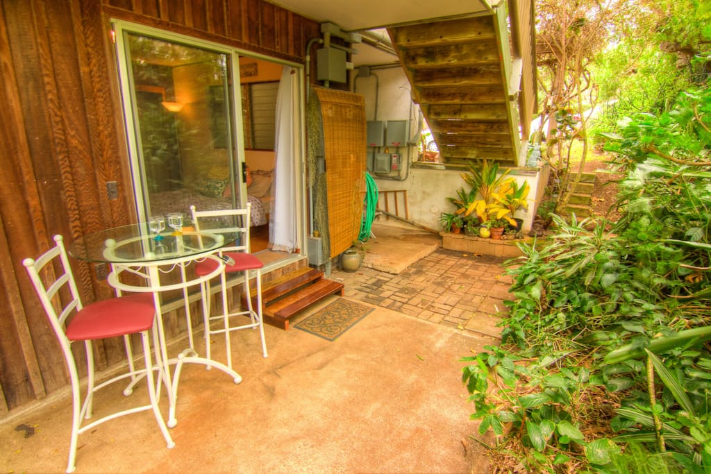 Your private entrance and garden-side bistro table.