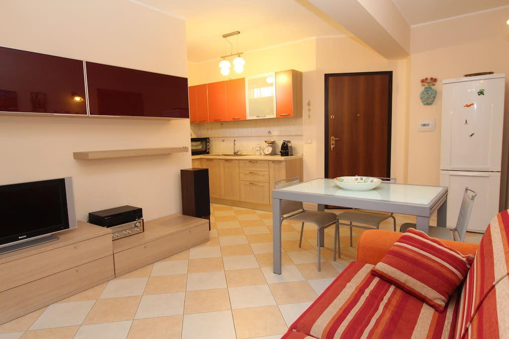 The living room with the kitchenette