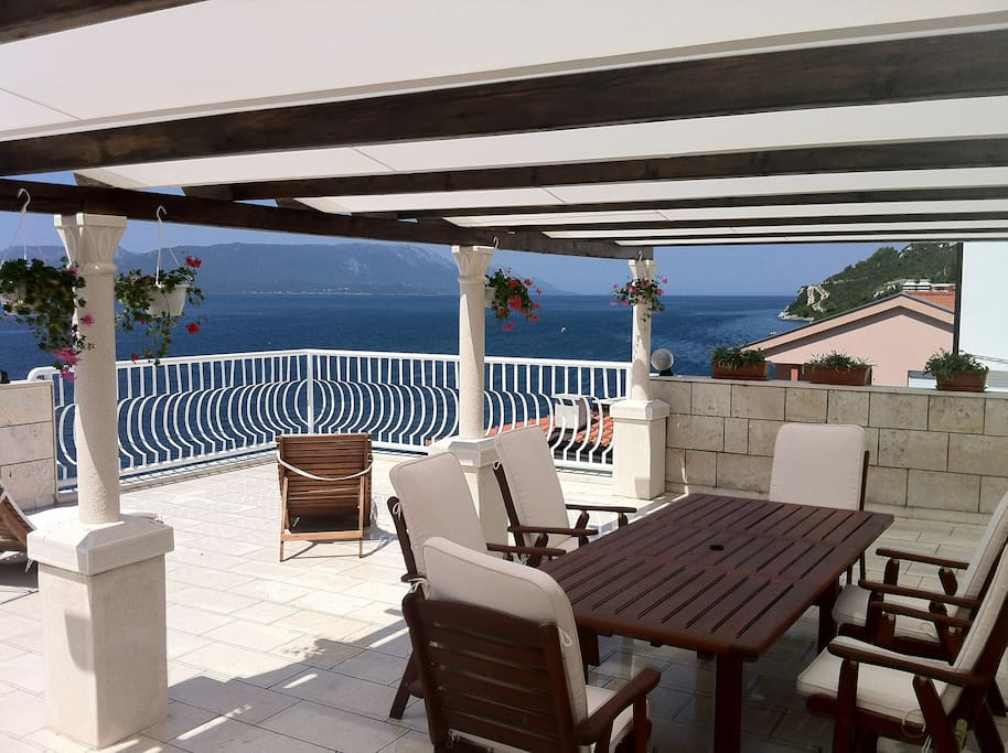 What makes the apartment special is the terrace. The size is 100 m2, there are barbecue, good furniture and a fantastic unbroken view over the sea and the islands.