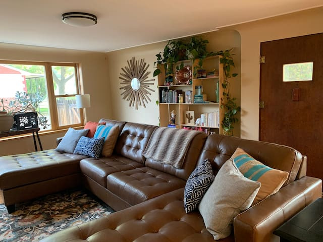 Living room with large leather couch.