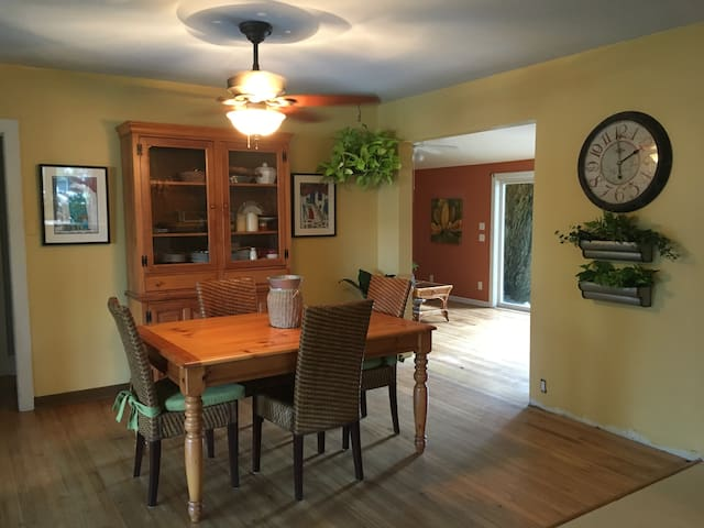 Dining room looks both ways towards both gardens outback and front. Table seats 6 comfortably and Hutch is full of dining necessities.