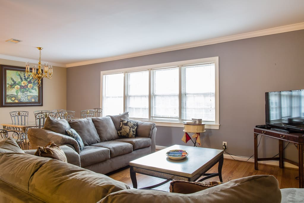 Lovely living room with ample sunlight for you to enjoy your family and friends