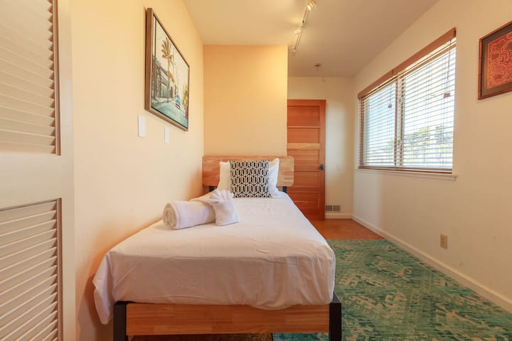 Our mini 3rd bedroom and office with twin bed