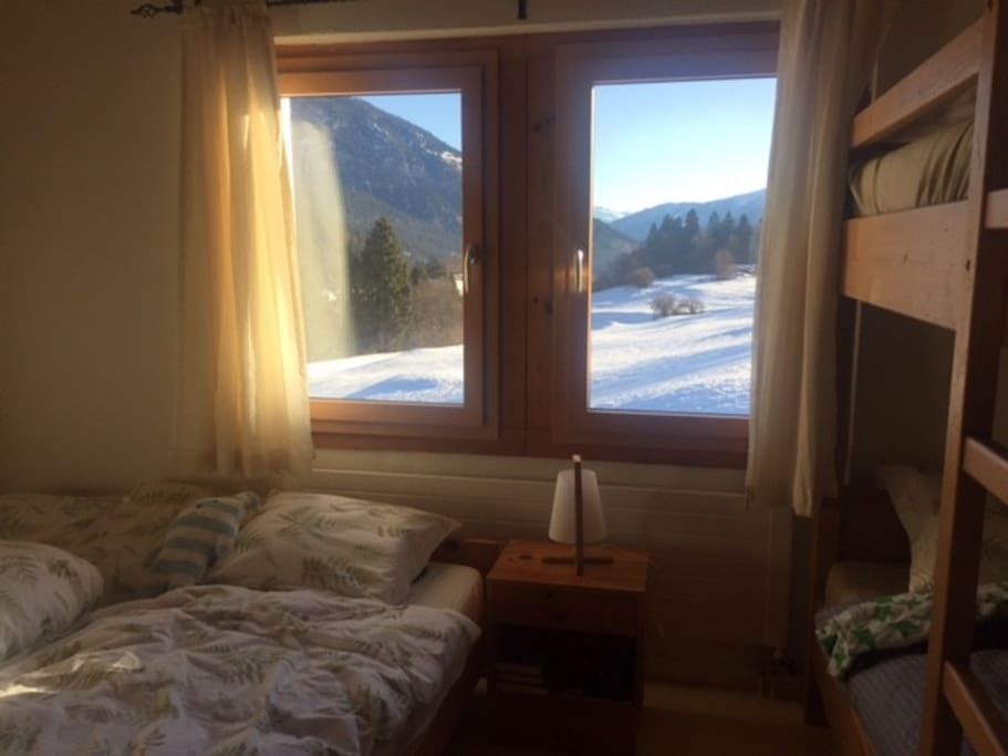 Comfortable bedroom with a double bed and a bunkbed