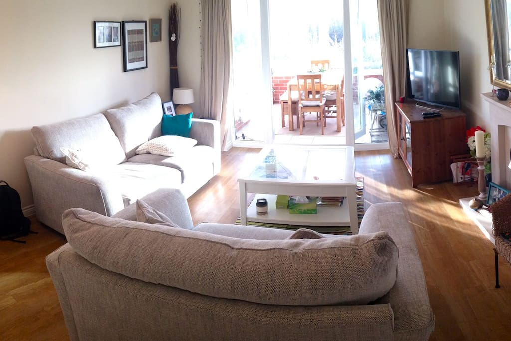 Our comfy lounge and dining area in conservatory.