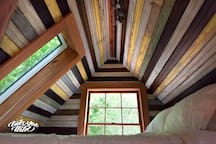 Lindsay Appel's shot of the cozy memory foam mattress loft of the treehouse with views into the bamboo