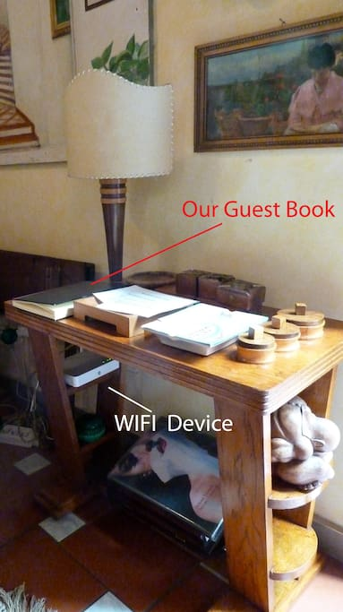 detail of the living room - WIFI device and Guest book