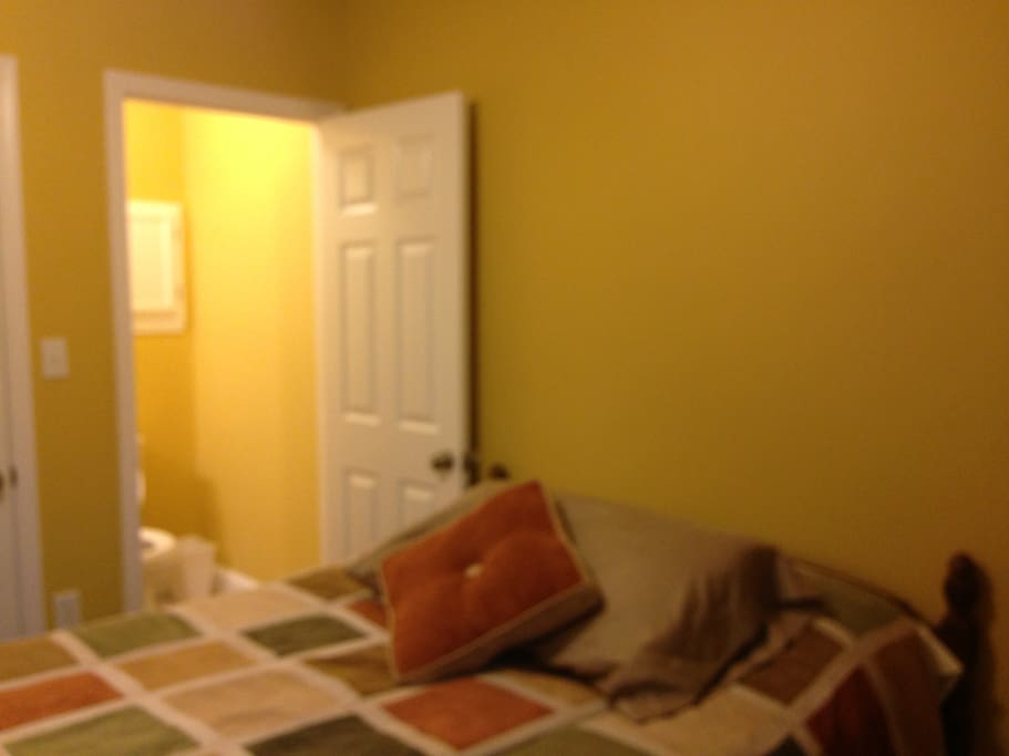 This is the bedroom 1 with a half bath.