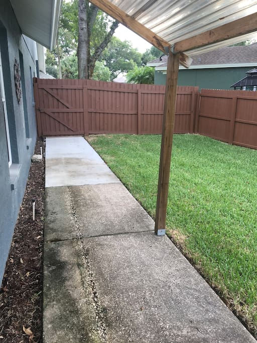 Sidewalk, side yard & entry to apartment