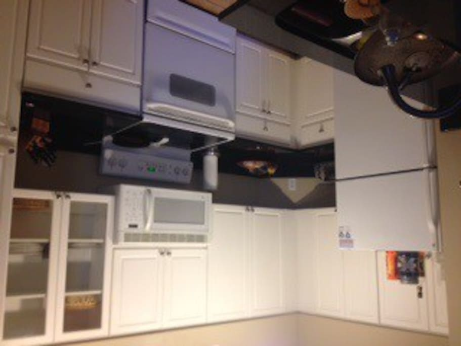 Remodeled kitchen with black granite counters, stove, microwave, refrigerator, dishwasher, garbase disposal.