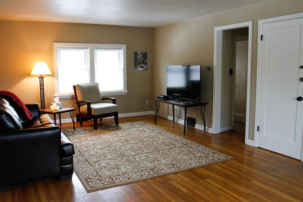 "IThe living room features a 55"" TV with DVD player and basic cable."