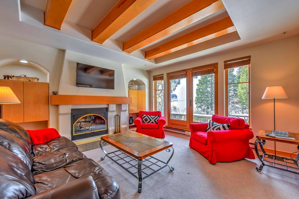 Relax in the inviting living room with plush seating and natural lighting.