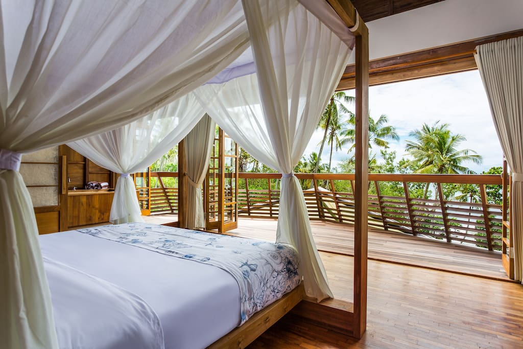 Master bedroom with private balcony overlooking the ocean