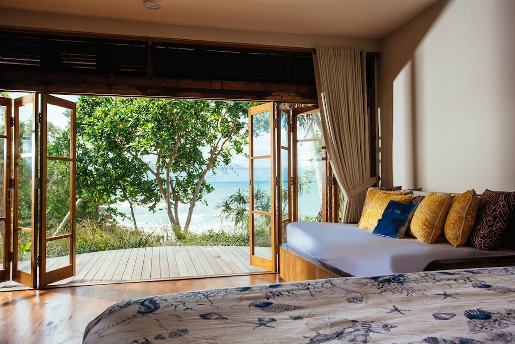 Guest house bedroom with private patio and full ocean view