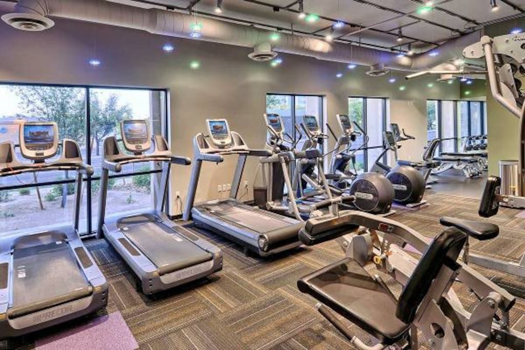 Cardio and weight machines in fitness center.