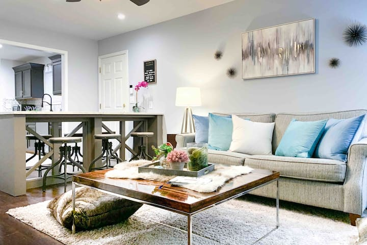 Cozy living room sofa converts to queen sofa bed. We  have a4 inch trifold to put over the sofa bed if you need more support. Why add this? We offer options. We value our sleep. What better way to serve our guests than prioritizing their sleep too?