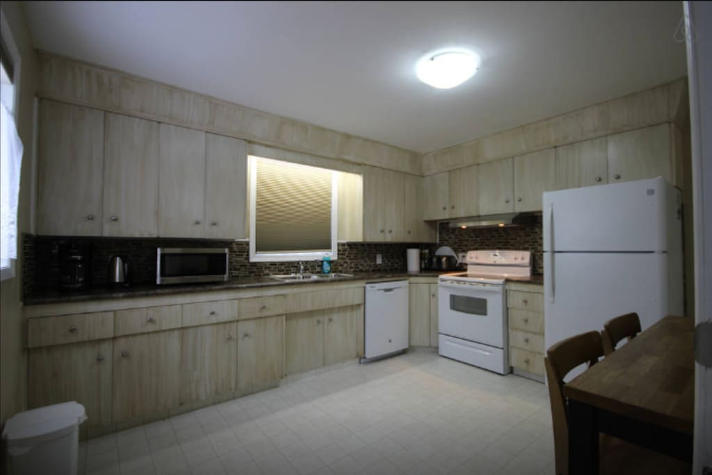 This is the main floor kitchen. Fully stocked and also includes condiments, coffee,