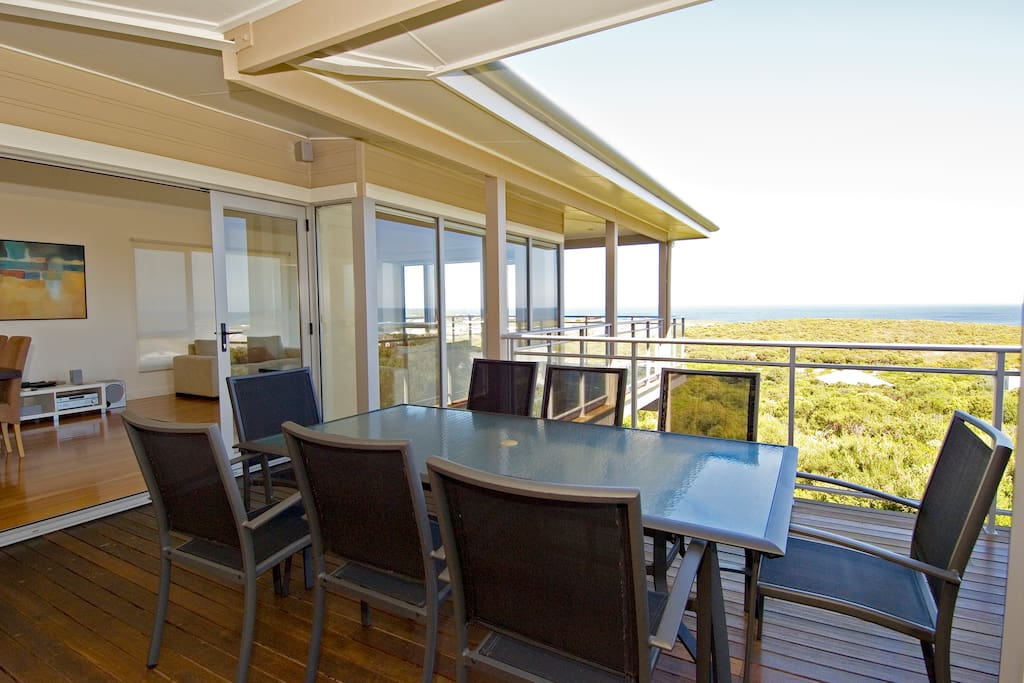 The spacious upstairs living area opens up to the balcony
