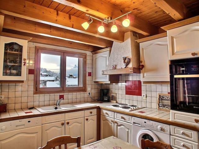Very convenient kitchen equipped with washing machine and dish washing machine.