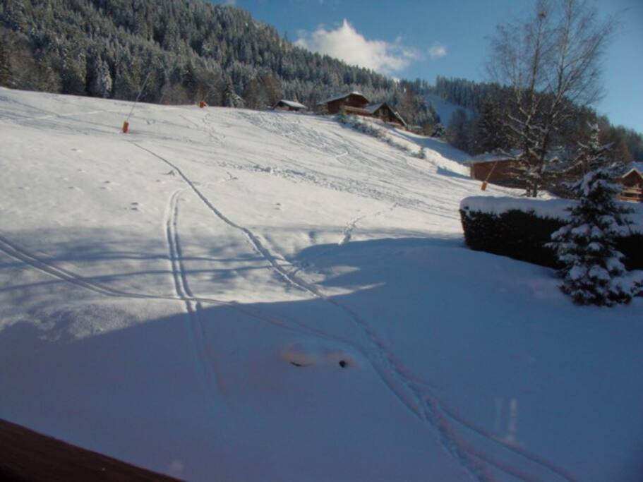 View on the slope from the balcony. Enjoy ski in / ski out.