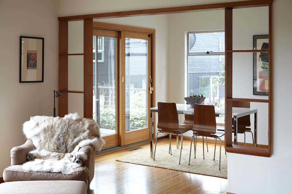 Dining room connected to living room for easy entertaining. Large view window to Portage Bay, overlooking yacht club. French doors to large deck facing Cascade mountain range.