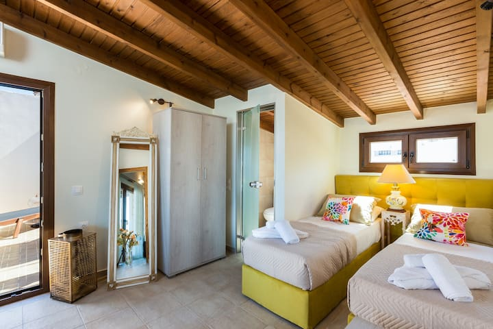 Bedroom with 2 single beds on the attic, reached through the master bedroom
